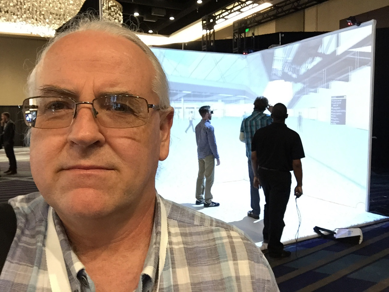 Dr. Webster with VR demo in background at SPAR 3D Conference